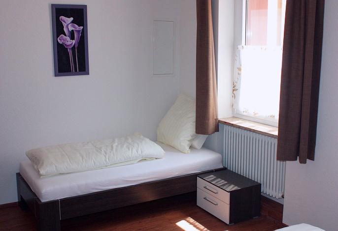 Ferienwohnung EG: Schlafzimmer